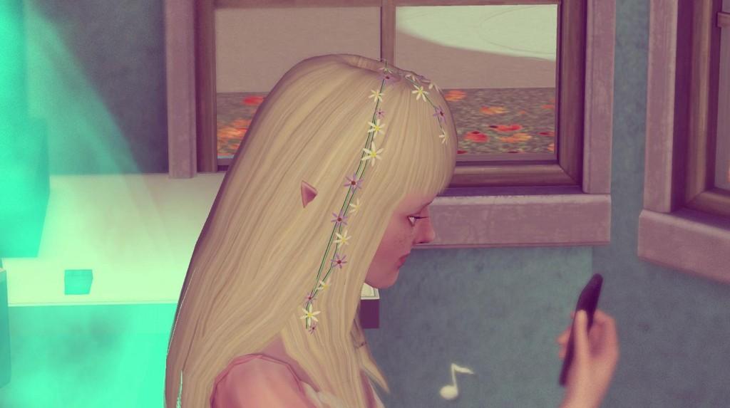 Elena schaut traurig auf ihr Telefeon